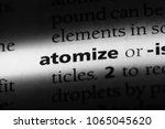Small photo of atomize word in a dictionary. atomize concept.