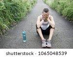 frustrated female runner... | Shutterstock . vector #1065048539