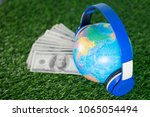 collecting money for travel... | Shutterstock . vector #1065054494