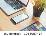 smartphone and laptop on table... | Shutterstock . vector #1065087419
