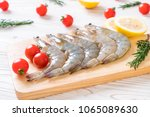 fresh shrimps or prawns raw on... | Shutterstock . vector #1065089630