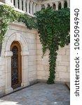 old wooden door in arched...   Shutterstock . vector #1065094940