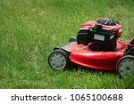close up on lawn mower on green ... | Shutterstock . vector #1065100688