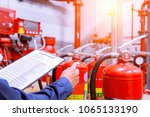 engineer checking industrial... | Shutterstock . vector #1065133190