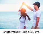 young couple dancing at beach... | Shutterstock . vector #1065133196