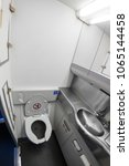 inside of airplane toilet | Shutterstock . vector #1065144458