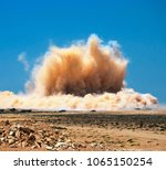 Small photo of Dust clouds after the huge blast