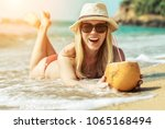 portrait of smiling young woman ... | Shutterstock . vector #1065168494