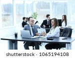 employees using digital tablet... | Shutterstock . vector #1065194108