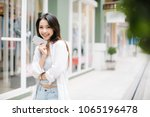 asia woman using with smart... | Shutterstock . vector #1065196478
