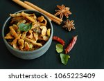 fried fish with herbs and nuts. ... | Shutterstock . vector #1065223409