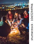 the happy people warming hands... | Shutterstock . vector #1065244946