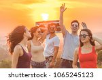 the happy friends with a boom... | Shutterstock . vector #1065245123
