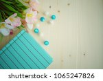 a notebook and flower on wooden ... | Shutterstock . vector #1065247826