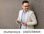 handsome young businessman with ... | Shutterstock . vector #1065258404