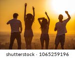 the four people dancing on the... | Shutterstock . vector #1065259196