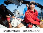 attractive strong woman sailing ... | Shutterstock . vector #1065263270