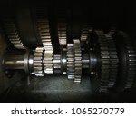 stained gears in shadow   Shutterstock . vector #1065270779