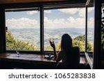 stylish girl traveler sitting... | Shutterstock . vector #1065283838