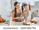young nanny with cute little... | Shutterstock . vector #1065286796