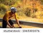 asian men are cycling road bike ... | Shutterstock . vector #1065301076