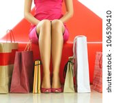 woman with bags in shopping mall | Shutterstock . vector #106530410