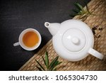 cup of hot tea with steaming... | Shutterstock . vector #1065304730