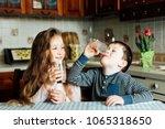 children drink milk in the...   Shutterstock . vector #1065318650