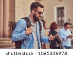 tourist with a full beard and... | Shutterstock . vector #1065326978