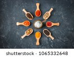 various indian spices in wooden ... | Shutterstock . vector #1065332648