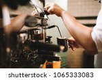 barista making coffee using a... | Shutterstock . vector #1065333083