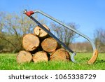 wooden logs wit hand saw in... | Shutterstock . vector #1065338729