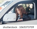 girl in a leather jacket  sits... | Shutterstock . vector #1065373709
