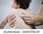doctor examining asian baby...   Shutterstock . vector #1065378119