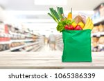 food and groceries in green eco ... | Shutterstock . vector #1065386339