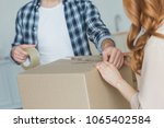 cropped shot of couple packing... | Shutterstock . vector #1065402584