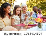 family and friends having lunch ... | Shutterstock . vector #1065414929