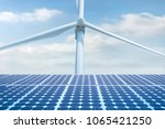Stock photo photovoltaic solar cell solar panal with wind turbines generating electricity renewable energy 1065421250