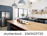 kitchen island in a large... | Shutterstock . vector #1065425720