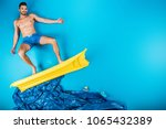 handsome young man in shorts... | Shutterstock . vector #1065432389