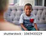 young boy having therapy with a ... | Shutterstock . vector #1065433229