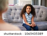 young girl having therapy with... | Shutterstock . vector #1065435389