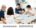 happy asian extended family... | Shutterstock . vector #1065435416