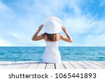 back view of a young girl... | Shutterstock . vector #1065441893