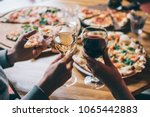 various pizzas and glasses of... | Shutterstock . vector #1065442883