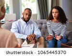 Small photo of Young couple having marriage counselling