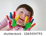 cute little girl with painted... | Shutterstock . vector #1065454793