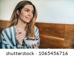 woman close up eating oat and... | Shutterstock . vector #1065456716