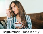 woman close up eating oat and... | Shutterstock . vector #1065456719