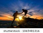 young asian couple climbing up... | Shutterstock . vector #1065481316